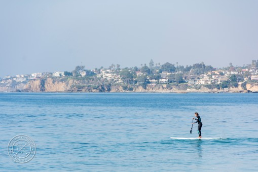 A woman using a standing on a Paddleboard on the ocean at Laguna Beach, California, USA.
